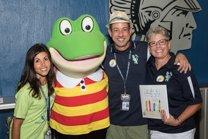 Mrs. Mucino, Froggy, Mr. Hens and Mrs. Norris at the Reading Caravan
